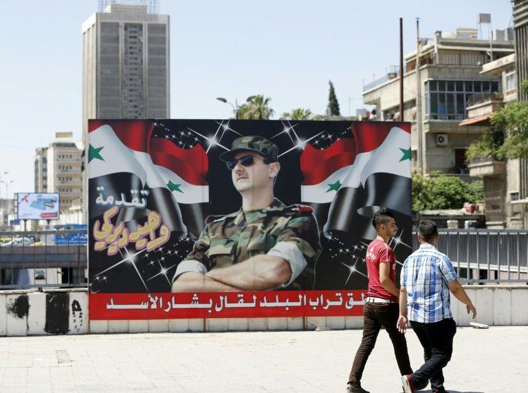 صورة طرقية لرئيس النظام السوري (إنترنت)