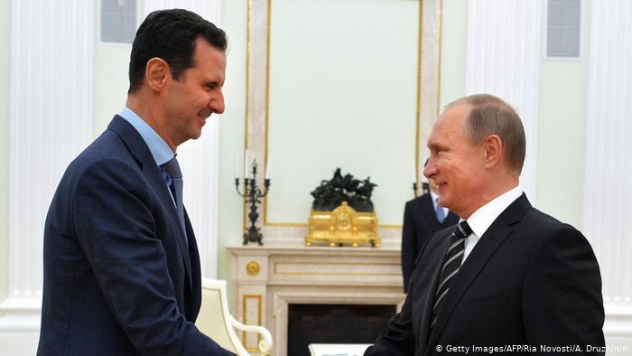 الرئيس الروسي فلاديمير بوتين مع رئيس النظام بشار الأسد (Getty)