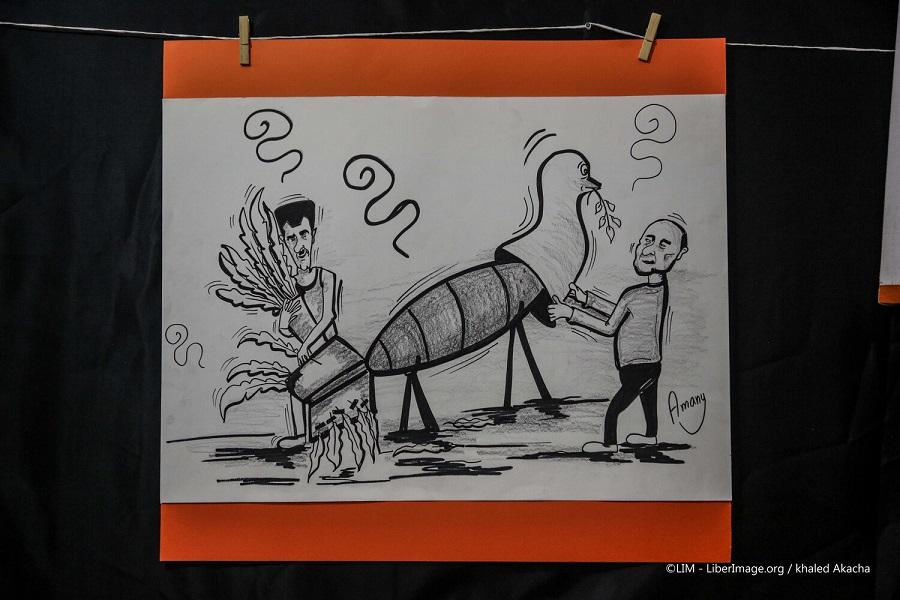 """من معرض للرسوم الكاريكاتيرية  في شمال سوريا تحت عنوان """" الأمل عم يكبر"""""""