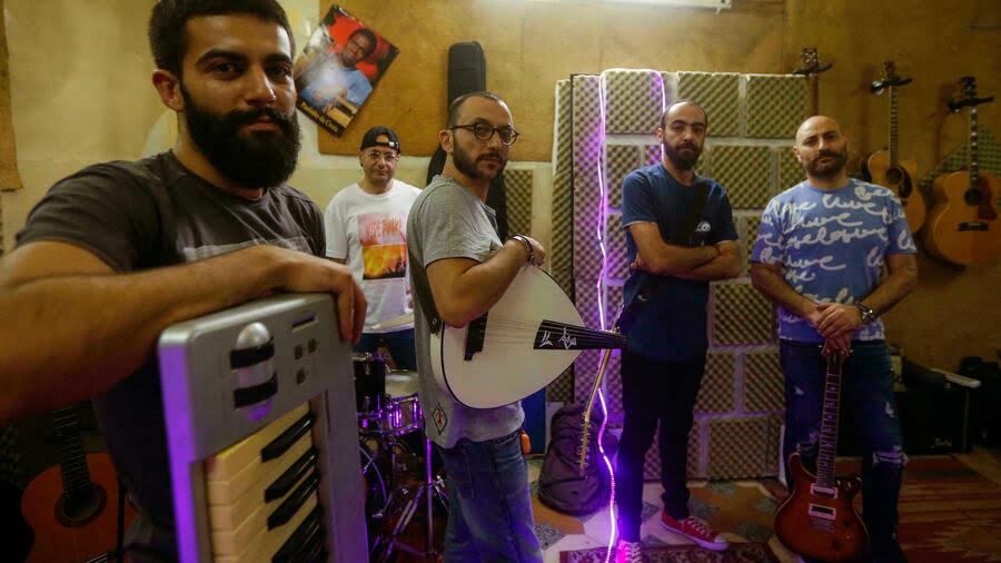 """فرقة سفر الموسيقية السورية أصحاب أغنية """"يا ويل ويلي"""" في دمشق في 13 آب/أغسطس 2021 لؤي بشارة ا ف ب"""